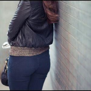 High rise dark denim jeans.