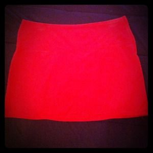 Red corduroy mini with zippered back pockets