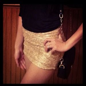 Sequin gold lacy mini skirt.