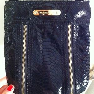 Black snake-embossed Michael Kors cross body bag