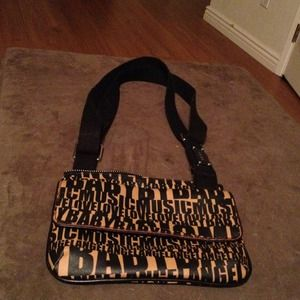 Adorable used once L.A.M.B cross body bag. Reserve