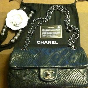 CHANEL Handbags - CHANEL leather embossed small flap bag