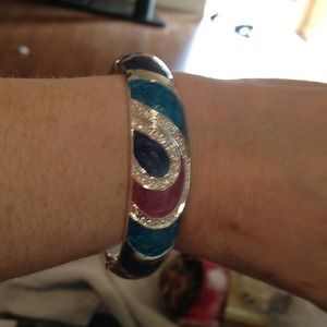 Silver and ceramic colored hinged bangle.