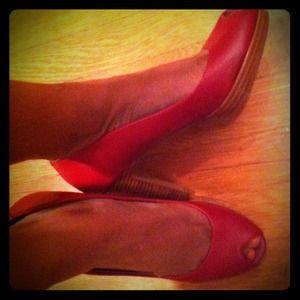 medium-shade red leather peep-toe platform heels