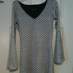 Modern silver and black dress with bell sleeves