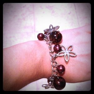 Jewelry - Large burgundy beads and flower charm bracelet