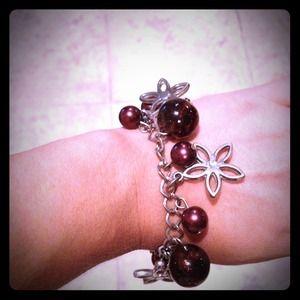 Large burgundy beads and flower charm bracelet