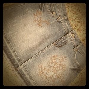 Denim - Distressed jean skirt with embroidered design