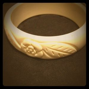 Ivory bangle with flower carving