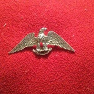 Silver tone eagle pin