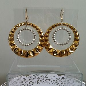 Gold and silver tone earrings.