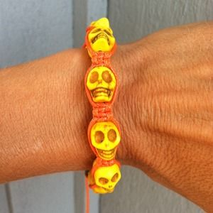 Jewelry - NWOT! Yellow/Orange Skull Arm Candy
