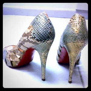 Authentic Christian Louboutin open-toe pumps.