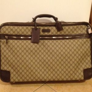 Authentic Gucci suitcase with tag and receipt