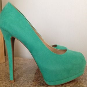 Teal suede pumps