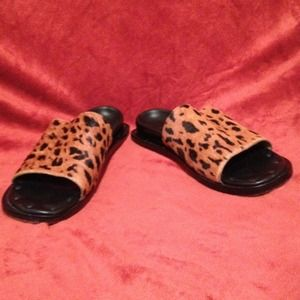 Animal print furry leather soaled shoes.