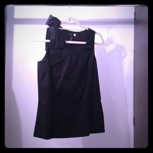 Black sleeveless top with bow