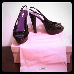 Pantent leather heels by Miu Miu