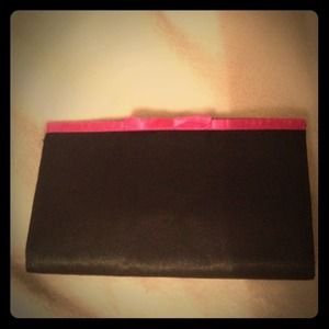 Black clutch with magenta bow 