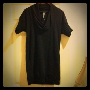 Black sweater dress with swooping neckline