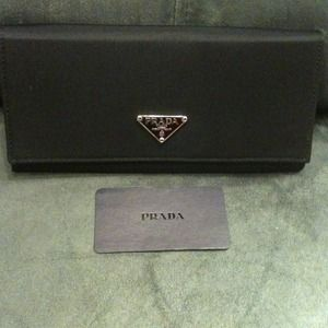 Prada Clutches & Wallets - PRADA black wallet pictures added not authentic