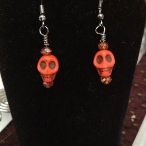 Dyed coral skull earrings