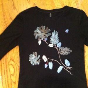 Tops - Black top with light blue flower appliqué