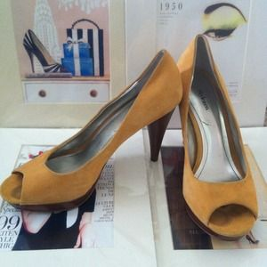 Canary yellow peep toe pumps