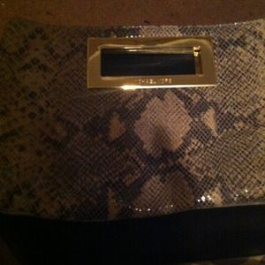 Snakeskin Michael Kors clutch with gold trimming