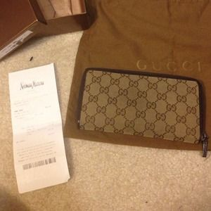 Gucci Clutches & Wallets - 💦💦SOLD Gucci Zip Around Wallet