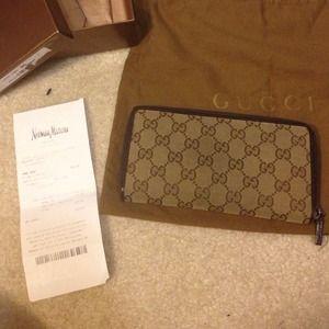Gucci Clutches & Wallets - 💦💦SOLD Gucci Zip Around Wallet