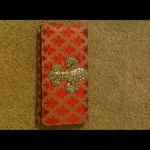 Red with rhinestone Fleur de Lis in middle.