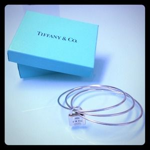 Tiffany & Co Jewelry - TIFFANY & CO TRIPLE BANGLE WITH TIFFANY LOCK CHARM