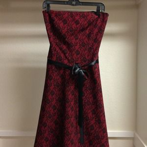 Charlotte Russe Dresses & Skirts - Red dress w/black lace print. Black ribbon tie.