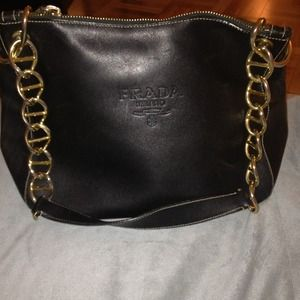 Authentic Prada black leather and hold chain bag