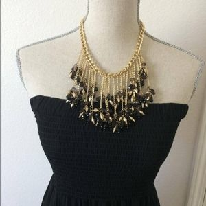 Beautiful gold cocktail necklace.