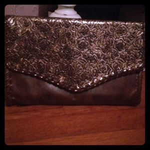 Gorgeous leather and gold-plated clutch