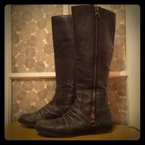 Tall black leather zipper boots