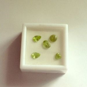 """Jewelry - """"SOLD """"Five Peridot stones various sizes."""