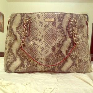 Kate Spade Snake handbag. Red trim w/ gold accents