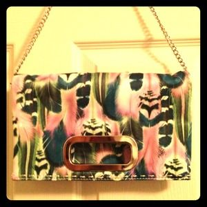 Clutches & Wallets - ⛔❌SOLD❌⛔ NEW Feather print clutch / purse