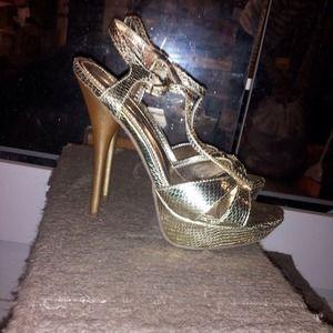 Gold stilettos.