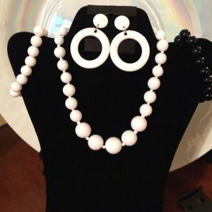 White beaded necklace and geometric earrings