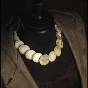 Circular horn statement necklace in cream