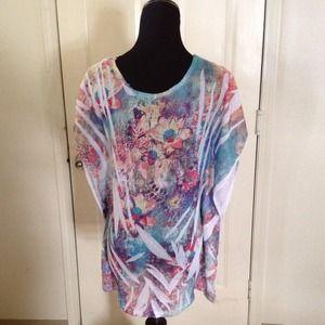 Tops - Flower design mesh shirt.
