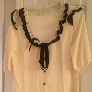 Sheer blouse super cute with 3/4 sleeves.