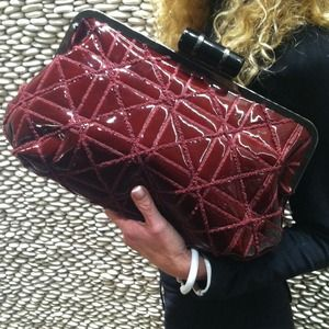 Red patent quilted clutch