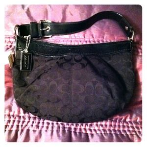 Coach black patent leather signature hobo bag