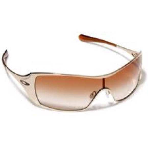 8de240a51274 First Edition Oakley Dart Sunglasses - Gold. M_50f8258f6056d57727004638