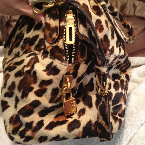 546e9f76a5d4 3% off Prada Handbags - Prada large leopard print fur bag from .